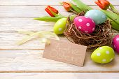 pic of wooden basket  - Easter basket with colored eggs and handwritten  - JPG