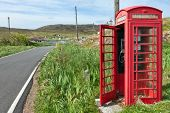 picture of phone-booth  - Traditional red phone box next to a single track road of Barra Outer Hebrides of Scotland - JPG