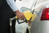 image of gasoline station  - Pumping gas - JPG