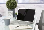 stock photo of newspaper  - Workplace with laptop computer - JPG
