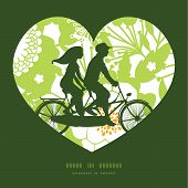 foto of tandem bicycle  - Vector green and golden garden silhouettes couple on tandem bicycle heart silhouette frame pattern greeting card template graphic design - JPG