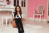 pic of mulatto  - A sexy mulatto woman in lingerie in a pink room with the words  - JPG
