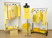 image of wardrobe  - Wardrobe full of all shades of yellow clothes shoes and accessories - JPG