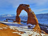 picture of arch  - Delicate Arch at sunset in Arches National Park Utah in winter - JPG