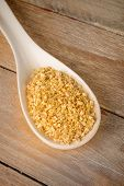 picture of citronella  - Dehydrated and chopped lemon grass on a spoon - JPG