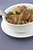 image of meatball  - Swedish meatballs in creamy gravy with curly egg noodles and grape jelly - JPG