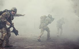 pic of smoke  - United States Army rangers during the military operation in the smoke and fire - JPG
