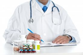 foto of pharmaceuticals  - Doctor writing medical prescription - JPG