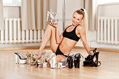 picture of pole dance  - Young Slim Pole Dance Blond Woman smile - JPG
