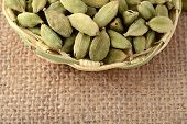 picture of cardamom  - Green Cardamom pods in bamboo basket on sack cloth - JPG