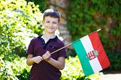 image of hungarian  - Little boy with Hungarian flag outdoor portrait - JPG