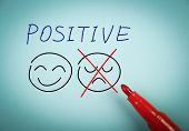 image of think positive  - Positive thinking concept is on blue paper with a red marker aside - JPG