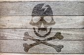 pic of pirate flag  - pirate icon on wood background rock style - JPG
