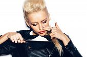 foto of swag  - Swag girl in black leather jacket sniffing cocaine  - JPG