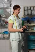 foto of icu  - Female nurse in ICU in the green uniform with defibrillator - JPG