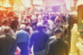 stock photo of urbanization  - Blurred Crowd of People On Street unrecognizable crowded population as blur urban background Vintage Toned Image - JPG