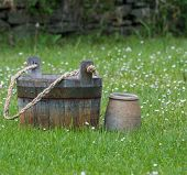 pic of pitcher  - Wooden bucket and a ceramic pitcher in a meadow - JPG