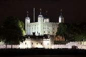 image of london night  - The Tower of London at night which was built by William The Conqueror in 1078 and is a Norman fortress and former royal palace standing on the north bank of the River Thames - JPG