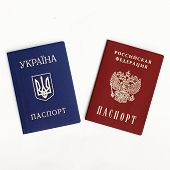 picture of passport cover  - an image of Ukrainian and Russian passports on a the white background - JPG