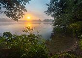 stock photo of morning sunrise  - Beautiful sunrise over misty lake - JPG