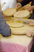 foto of tomas  - Womans making talos Tortilla than wraps txistorra in the Santo Tomas Fair held each year on December 21st in some parts of the Basque Country. Spain