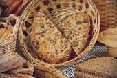 stock photo of fresh slice bread  - Sliced fresh bread in a wicker basket - JPG
