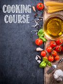 stock photo of sign board  - Cooking ingredients on blank dark board with cooking course sign - JPG