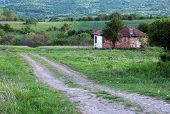pic of abandoned house  - Dirt road and abandoned house in Bulgaria in the spring - JPG