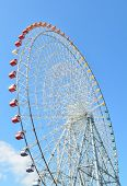 picture of ferris-wheel  - Close Up Of Ferris Wheel Over Blue Sky - JPG