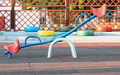 stock photo of seesaw  - Coloured seesaw on the playground - JPG