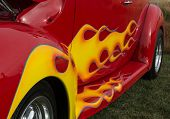 foto of rod  - Yellow flames painted on red hot rod with blue pinstripes - JPG