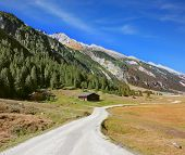 stock photo of dirt road  - Sunny autumn day - JPG