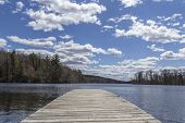 image of dock a lake  - Dock stretches across Wawayanda Lake in early springtime - JPG