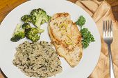 pic of crispy rice  - Crispy tender lemon chicken garnished with lemon twist with sides of herb wild rice and lemon broccoli - JPG