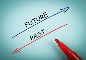 picture of past future  - Future and past concept is on blue paper with a red marker aside - JPG
