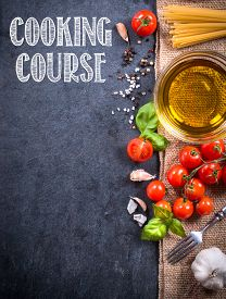 stock photo of sign-boards  - Cooking ingredients on blank dark board with cooking course sign - JPG