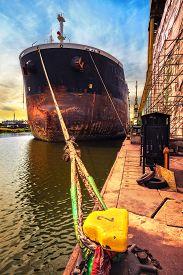 stock photo of shipyard  - Ship moored at quay in shipyard  - JPG