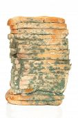 stock photo of penicillin  - Moldy sliced bread loaf isolated over white background - JPG