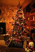 picture of christmas-present  - front room decorated for christmas with christmas tree stockings and fireplace - JPG