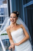 Постер, плакат: Bride near the glass wall