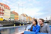 Copenhagen tourists people on cruise boat tour on water canal in old port Nyhavn. Young multiracial  poster
