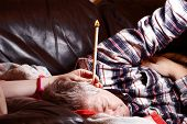 stock photo of ear candle  - Mature Male having hopi ear candle treatment