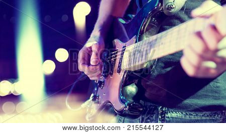 poster of Live music background.Concert and music festival.Instrument on stage and band.Stage lights.Abstract musical background.Playing guitar and concert concept