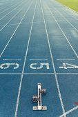Starting Block On A Running Track poster