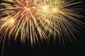 stock photo of guy fawks  - a golden burst of fire works from the top of the frame - JPG