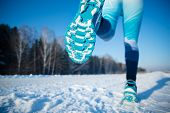 Winter Jogging - Winter Running In Snow. A Healthy Lifestyle. poster
