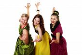 stock photo of parti poodle  - three stylish young woman in bright colour dresses - JPG