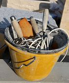Masonry Bucket With Tools For House Construction poster