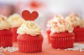 Tasty cupcakes for Valentines Day on table poster