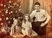 Christmas family photo with mother, father and girl in boxing day. Black and white Xmas vintage imag poster